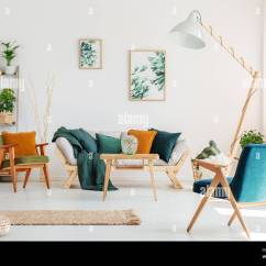 Blue Chair Living Room What Color Should I Paint My With A Grey Couch And Design Lamp In Natural Plants Two Paintings On White Wall