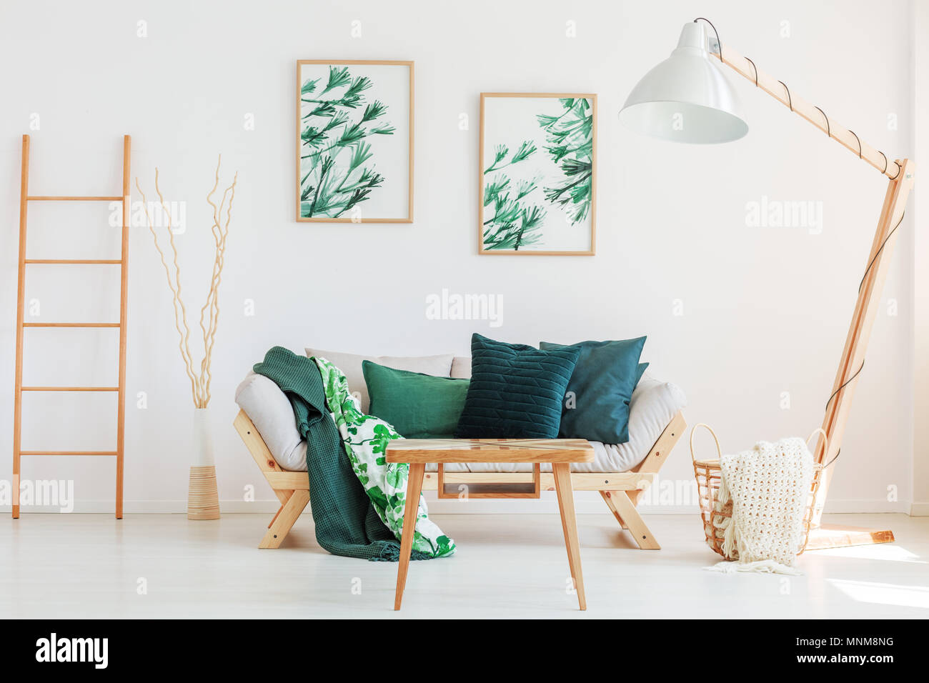 green floral sofa white and chair set wooden ladder branches in decorative vase next to