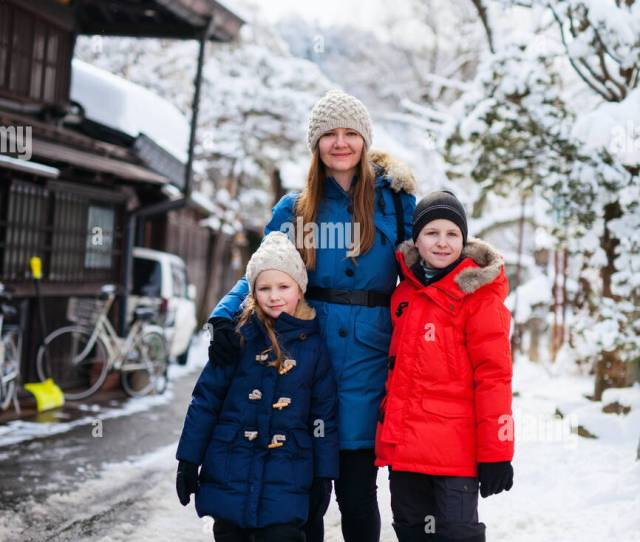 Family Of Mother And Kids At Old District Of Historical Takayama Town In Japan On Winter