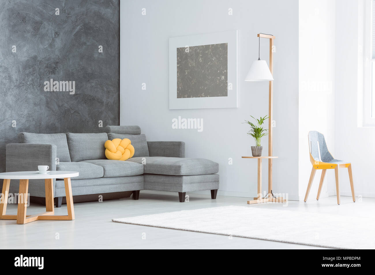 living room paint grey couch decorating ideas for with dark hardwood floors silver painting above set yellow pillow in spacious contrast walls