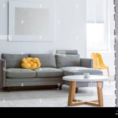 Living Room Decorative Pillows Design Program Yellow Pillow On Grey Sofa In With Brick White Wall And Simple Coffee Table