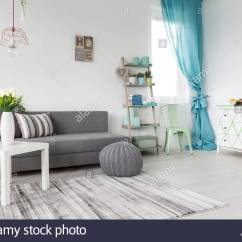 Curtains In Gray Living Room Wall Mounted Tv Design Grey With A Mint And White Walls Stock Photo