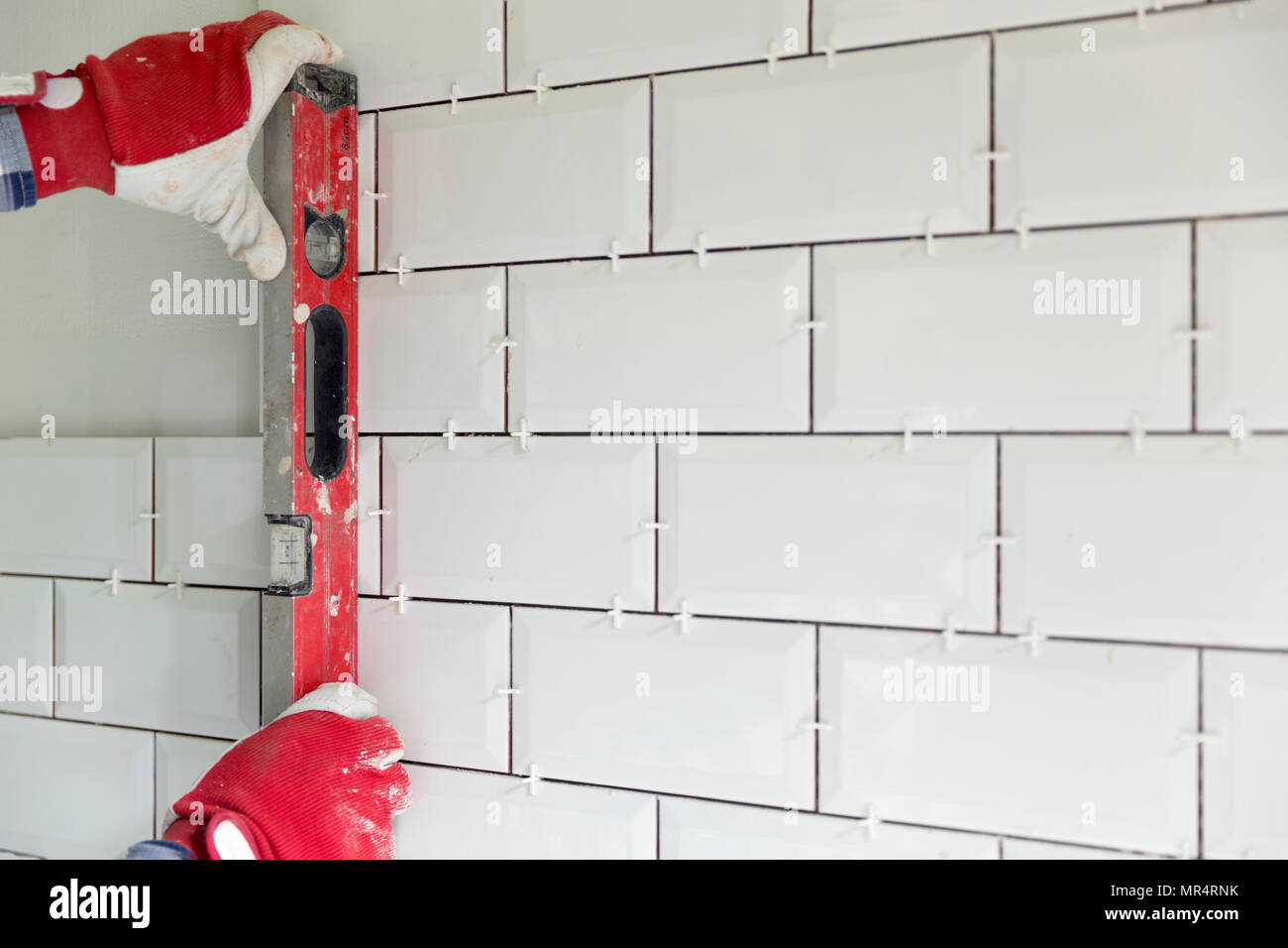 Process Of Tiling The Tiles In The Kitchen Contractor