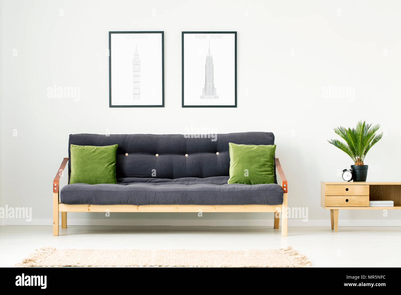 living room clocks next white sectional set dark grey sofa cushions in stock photos plant and clock on wooden cupboard to a settee with green natural