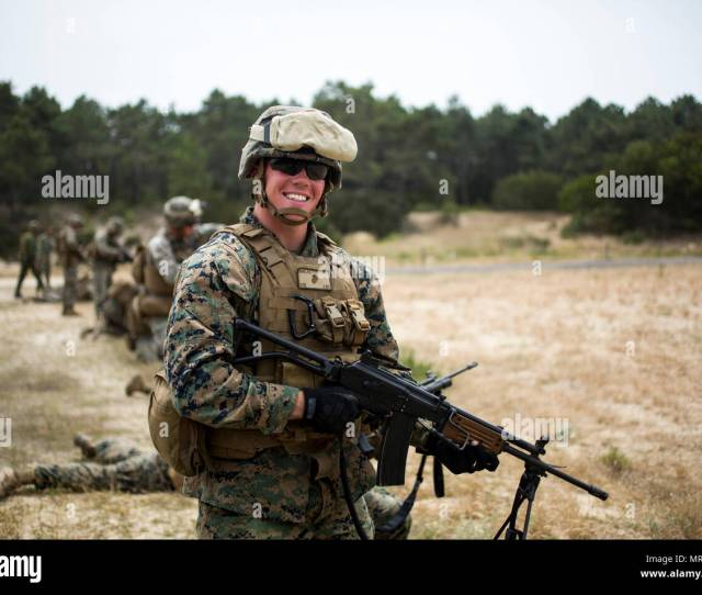Corporal Ben Gaige A Field Radio Operator Assigned To Special Purpose Marine Air Ground Task Force Crisis Response Africa Poses With An Imi Galil Rifle At