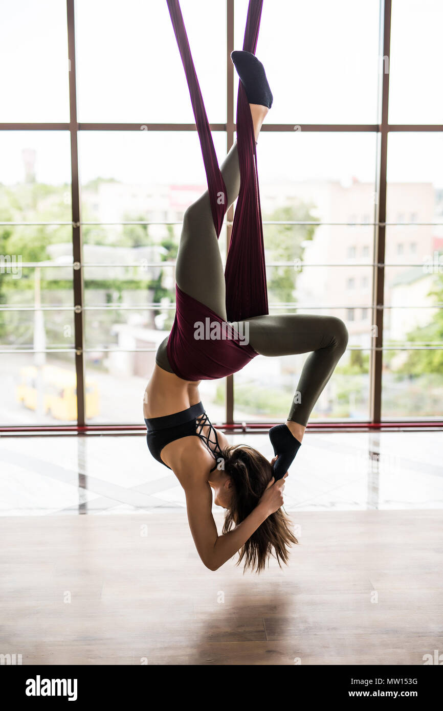 young woman practices aerial