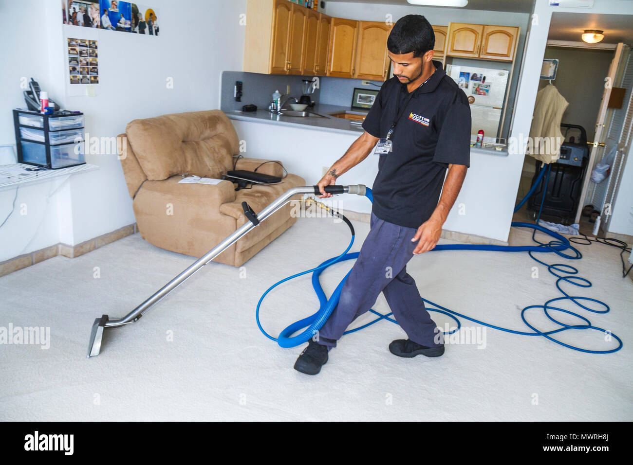 sofa cleaning miami beach rose acnl man home vacuum cleaner stock photos and