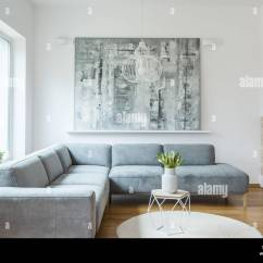 Painting Living Room Furniture White Rooms To Go Grey Corner Sofa Against Wall With In Minimal Interior Window