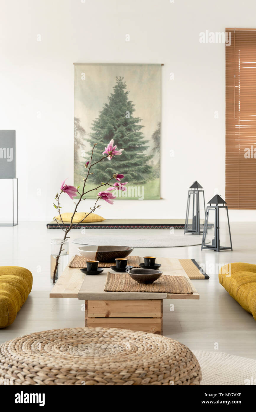living room pouf canvas art prints for close up of a in interior with coffee table cherry blossom lamps on the floor and tree poster