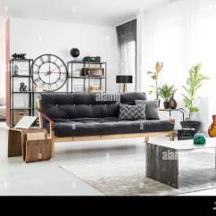 Dark Green Leather Sofa Sale Vintage Stock Photos Vase In Front Of A And Wooden Table With Laptop Man S Apartment