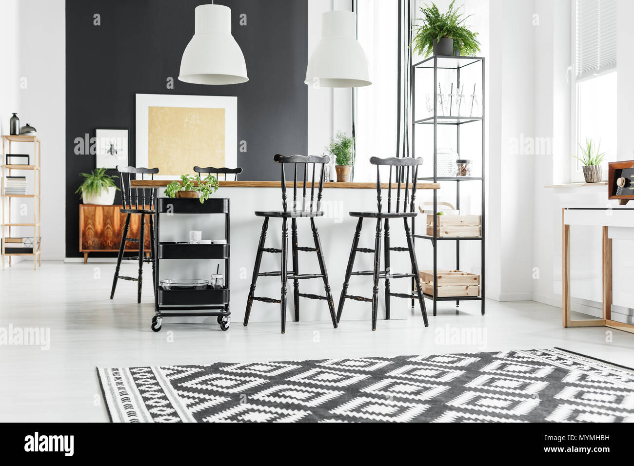 Black And White Geometric Carpet In Rustic Kitchen With Bar Stools At Wooden Countertop Stock Photo Alamy