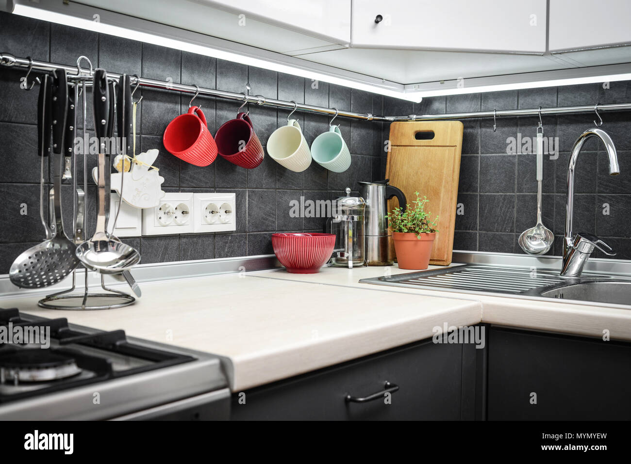 kitchen rail system cleaning supplies a fragment of the modern style with and utensils houseplant
