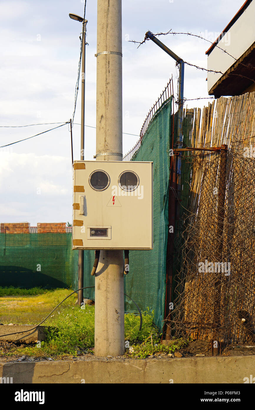 medium resolution of electricity meter box with round windows at pole