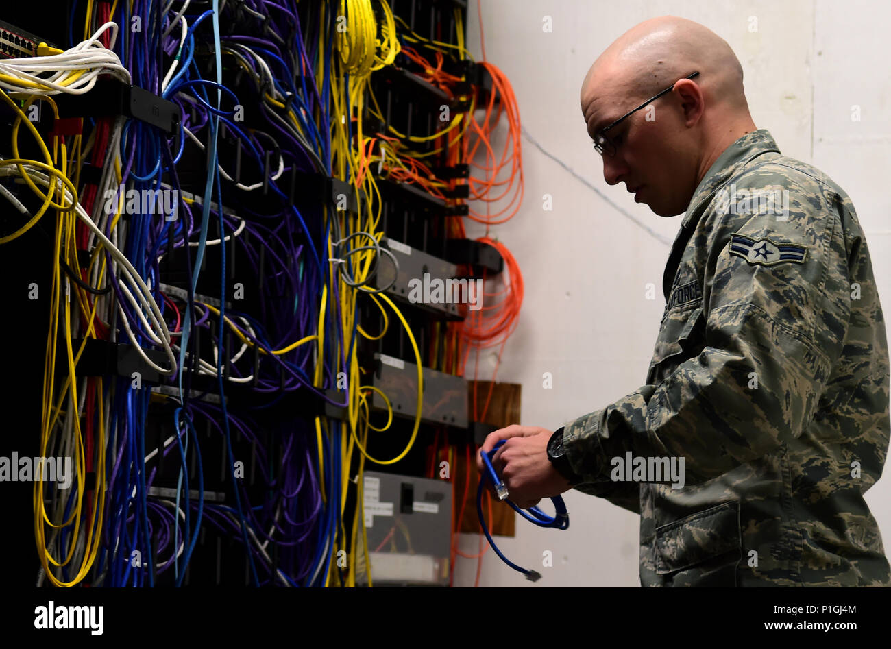 hight resolution of airman 1st class michael de la mater 460th space communication squadron network technician changes out an ethernet cable inside a communications closet