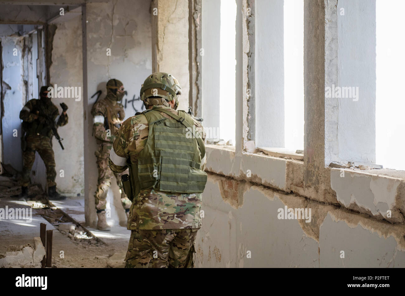 hight resolution of airsoft soldier side view aim target digital uniform camouflage stock image