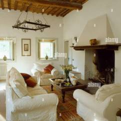 Living Room Covers Table White Loose On Sofa And Armchairs In Rustic Tuscan With Beamed Ceiling Low Front Of Fireplace