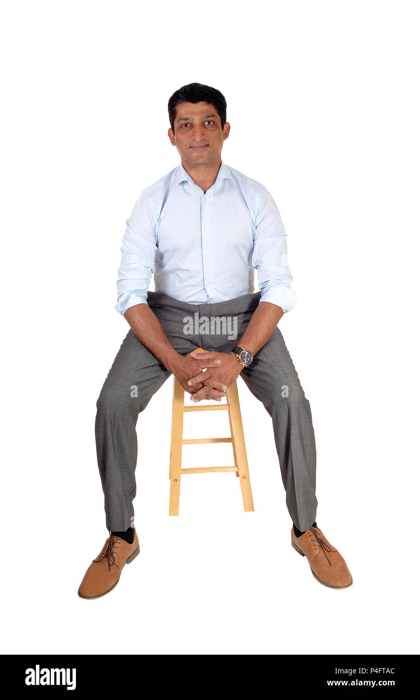 Chair Pants A Good Looking East Indian Man In A Suit Pants And Light Blue