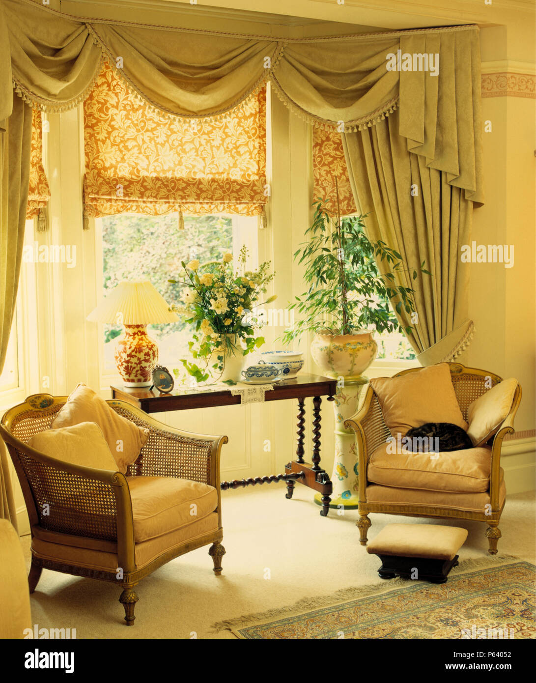 Living Room With Vintage Bergere Armchair Beside Bay Window