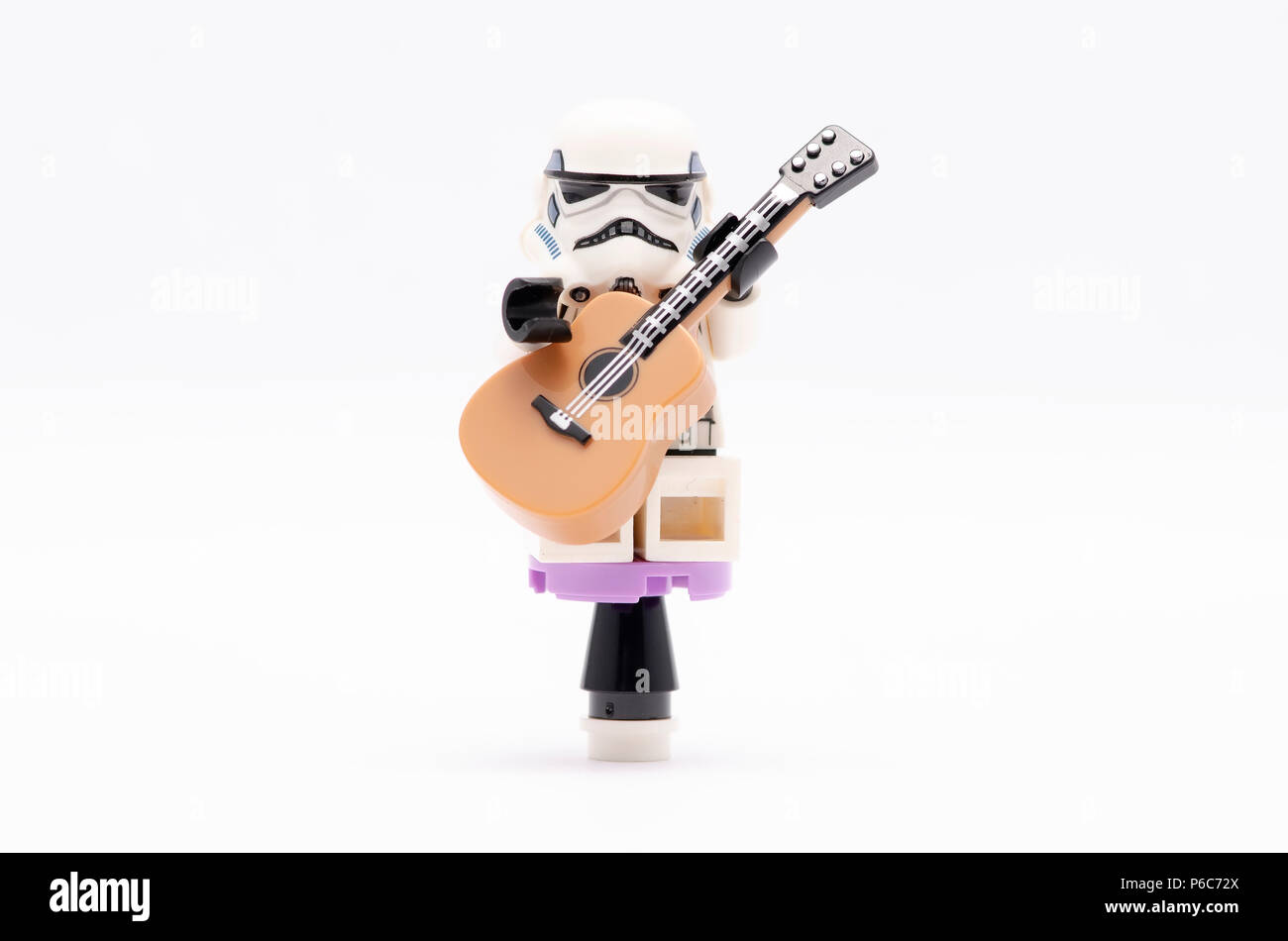 guitar playing chair stretch dining covers mini figure of storm trooper sitting on lego minifigures are manufactured by the group