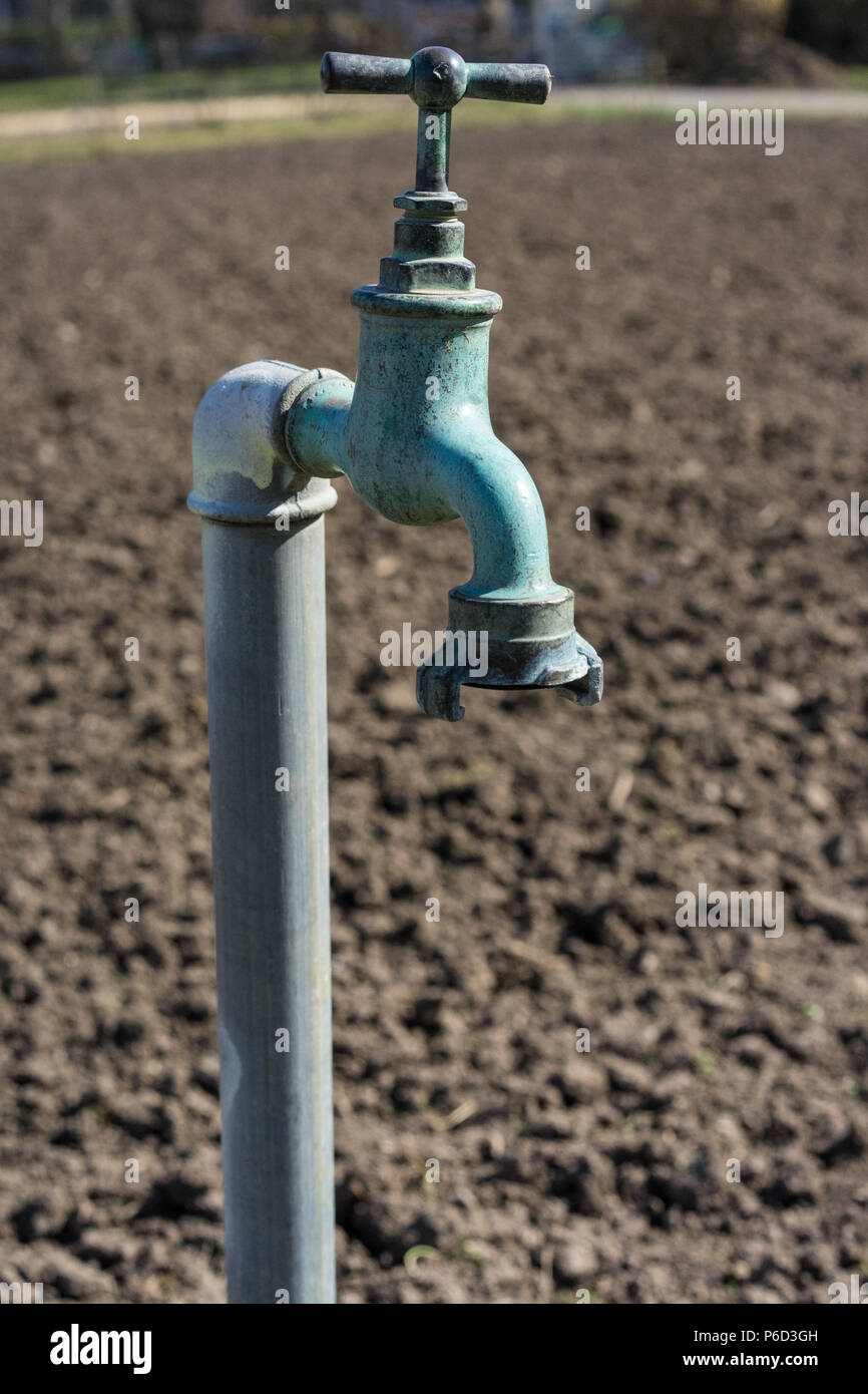 https www alamy com old water pipe outside faucet with nature background a old rusty water tap in garden image210500545 html