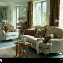 Images Of Small Country Living Rooms Traditional Room Sets Furniture Cream Sofa And Armchair With Brown Cushions In Tea Set On Wooden Stool