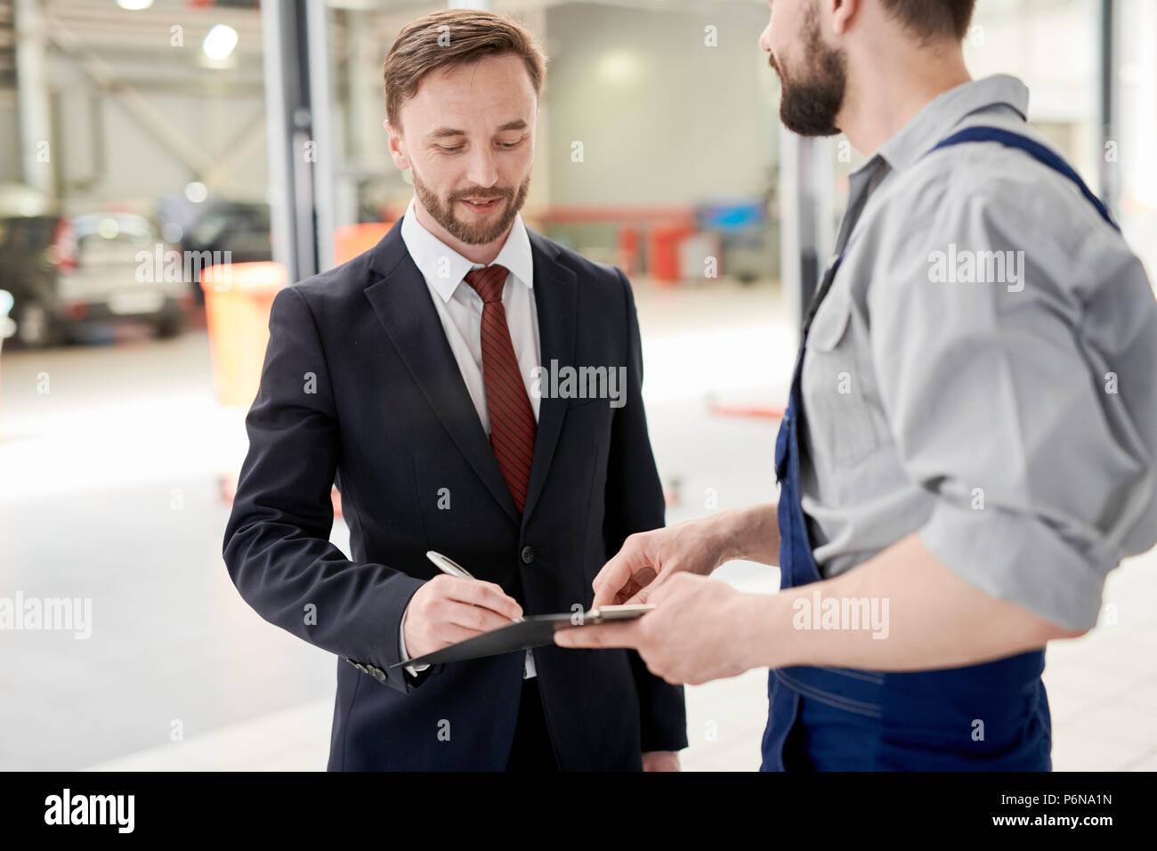 Businessman Signing Car Service Contract