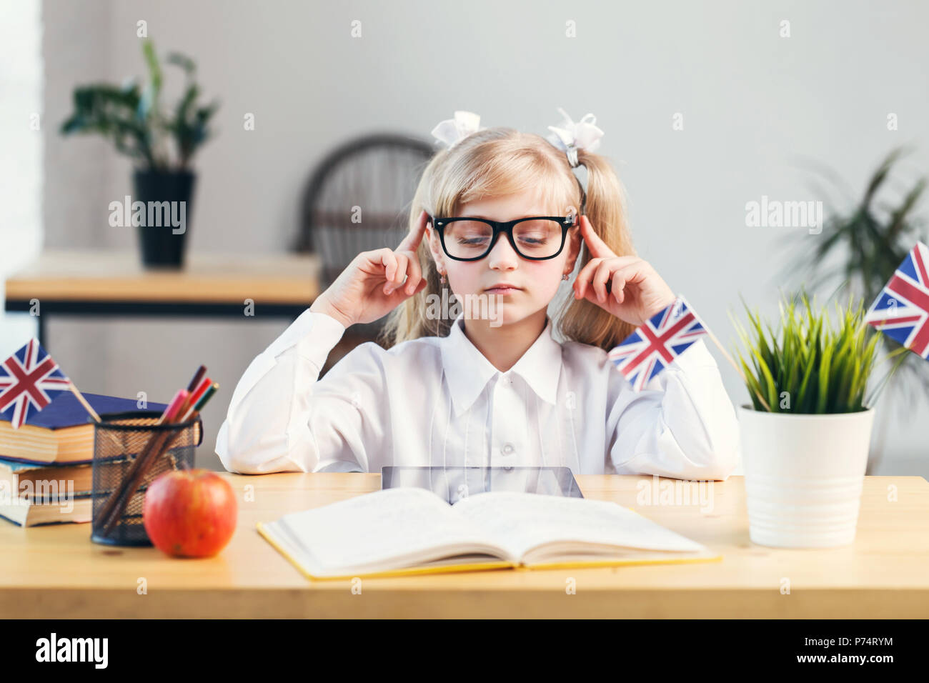 concentrated girl learning english