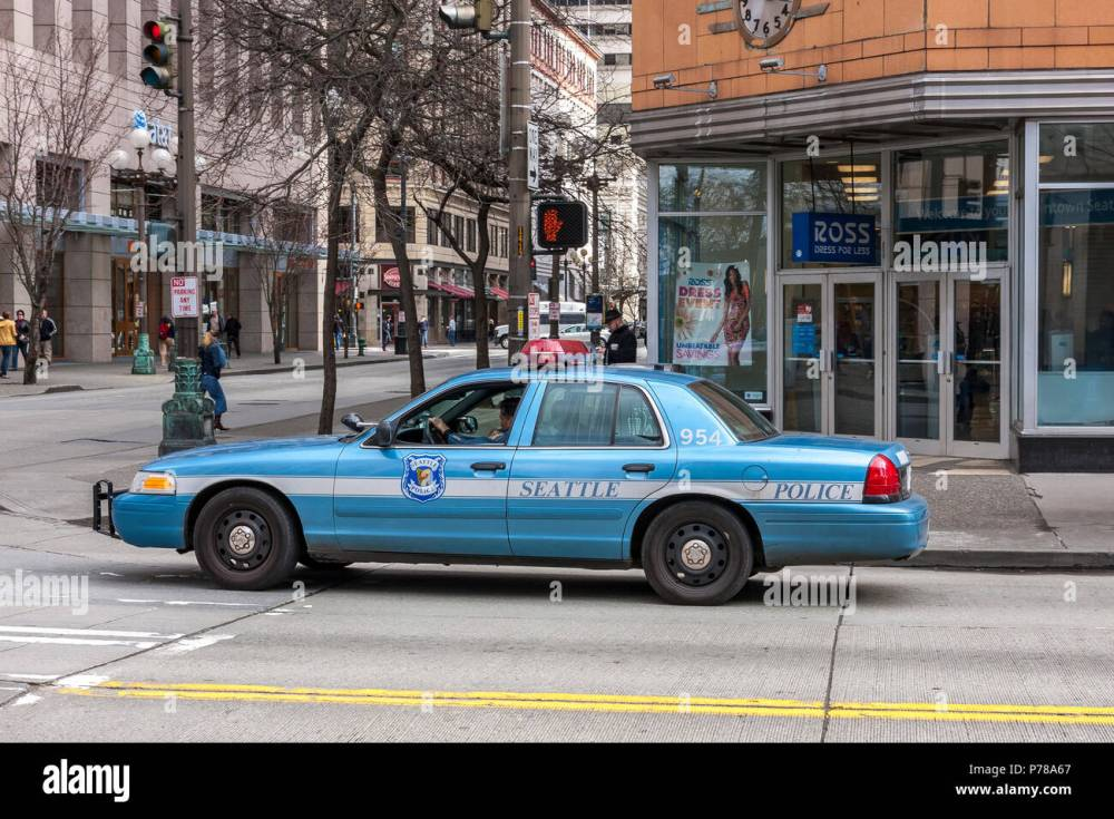 medium resolution of blue seattle police department ford crown victoria car on the streets of seattle stock image