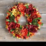 Colorful Wreath Made Of Wooden Flowers And Leaves On Vintage Wood Background Stock Photo Alamy