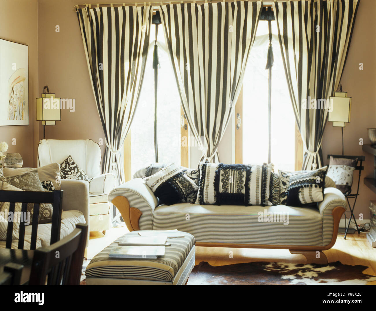 black and beige living room curtains trunk coffee table furniture white striped on glass doors behind sofa with cushions in