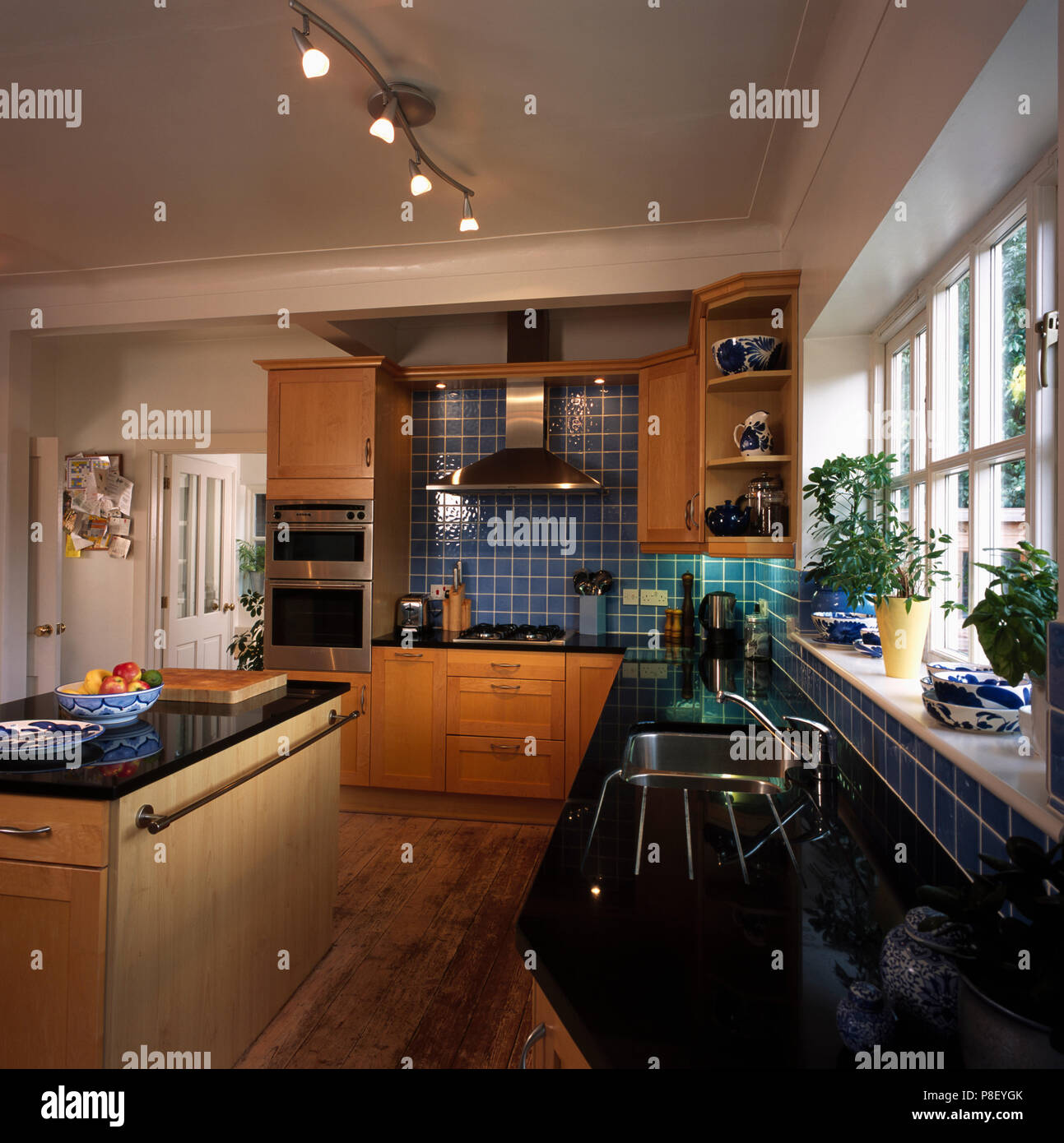 https www alamy com island unit and ceiling track lighting in modern kitchen with granite worktops image211770627 html