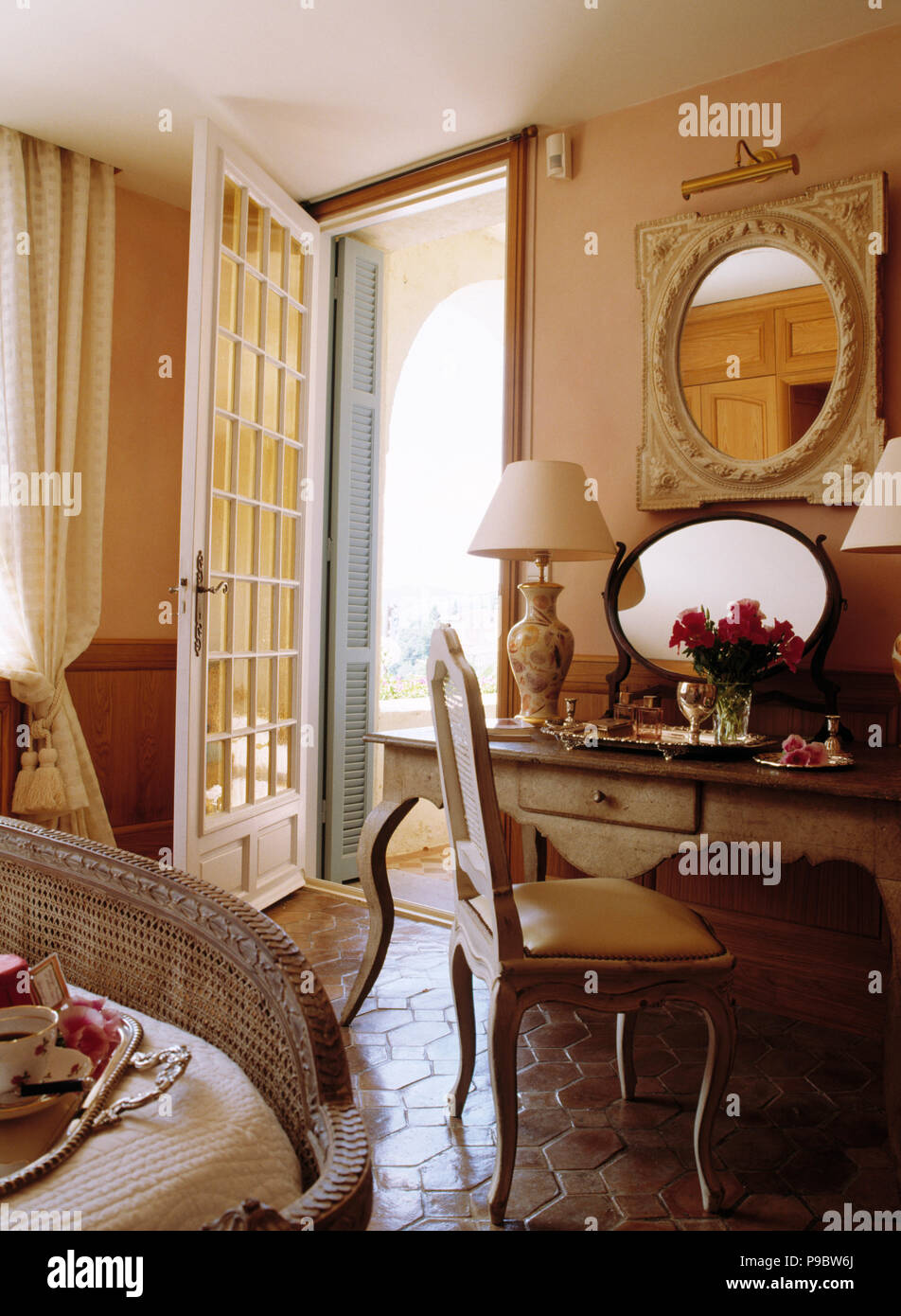 bedroom glass chair outdoor dining cushions sunbrella mirror above painted desk and in french coastal with door open to veranda