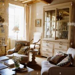 French Country Living Room Style Colors Comfortable Armchairs In With Glass Fronted Dresser And Rustic Beamed Ceiling