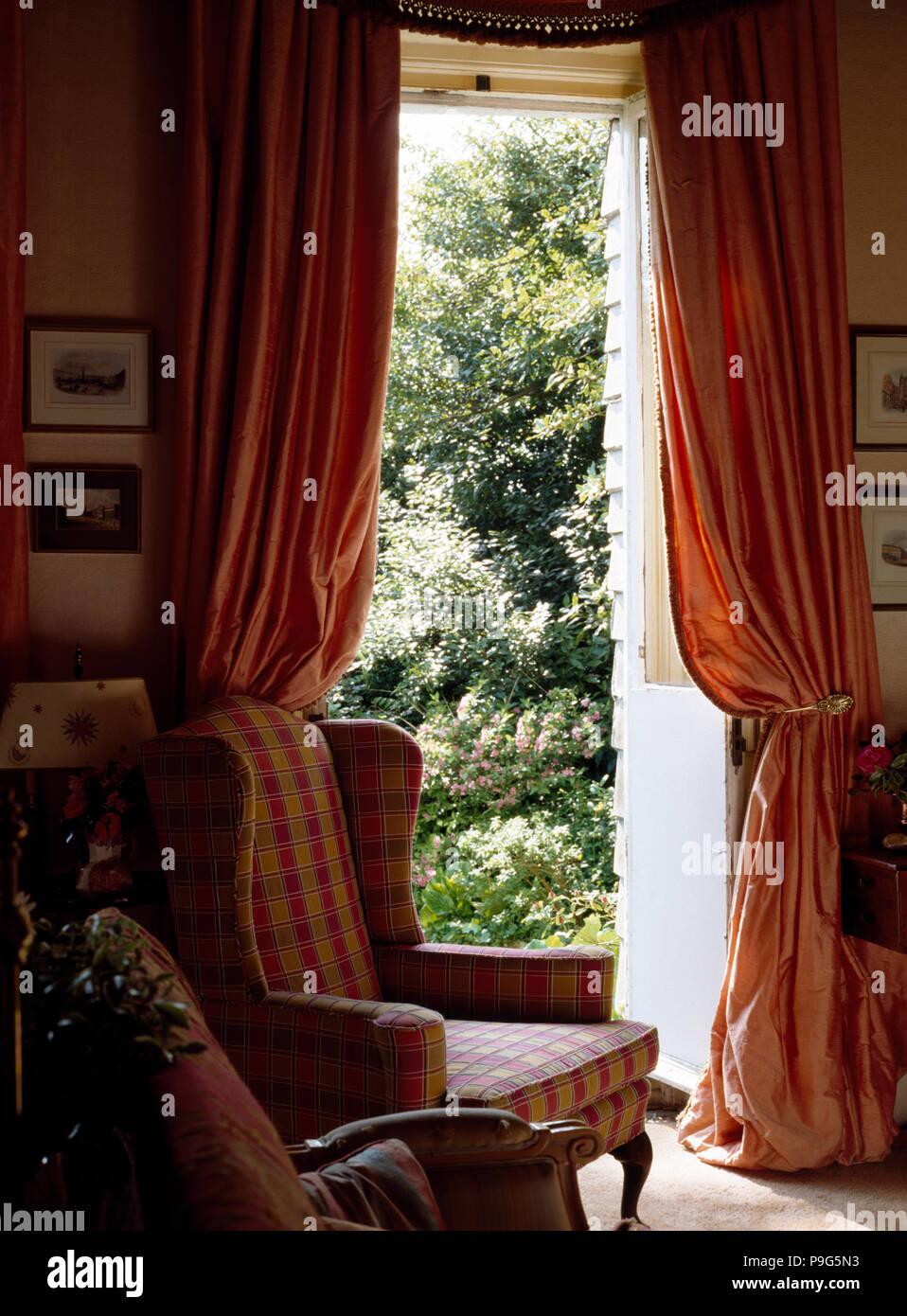 https www alamy com peach silk curtains on open door in eighties living room image212412063 html