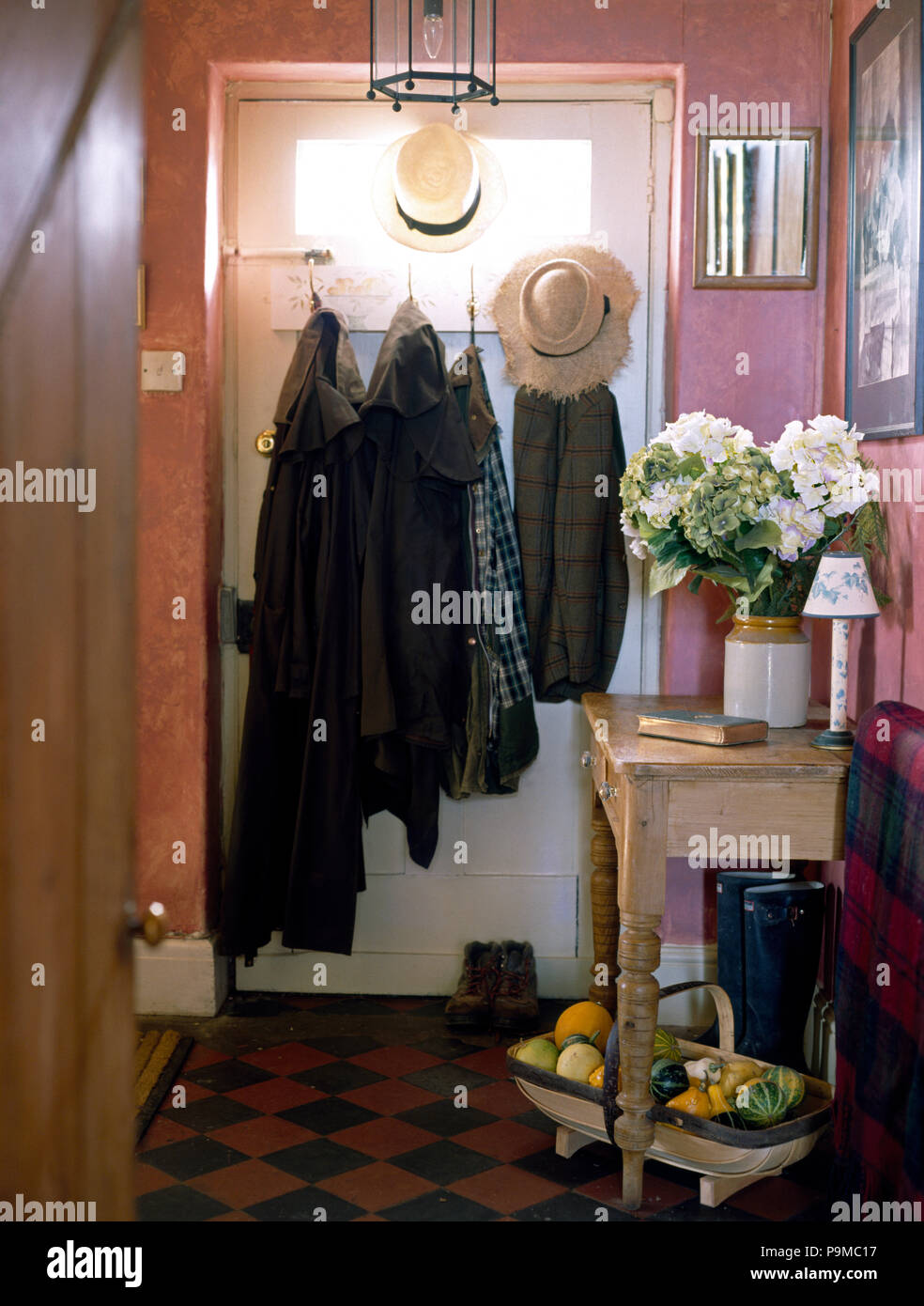 https www alamy com coats on the back of front door in pink cottage hall with an original red and black victorian tiled floor image212504803 html