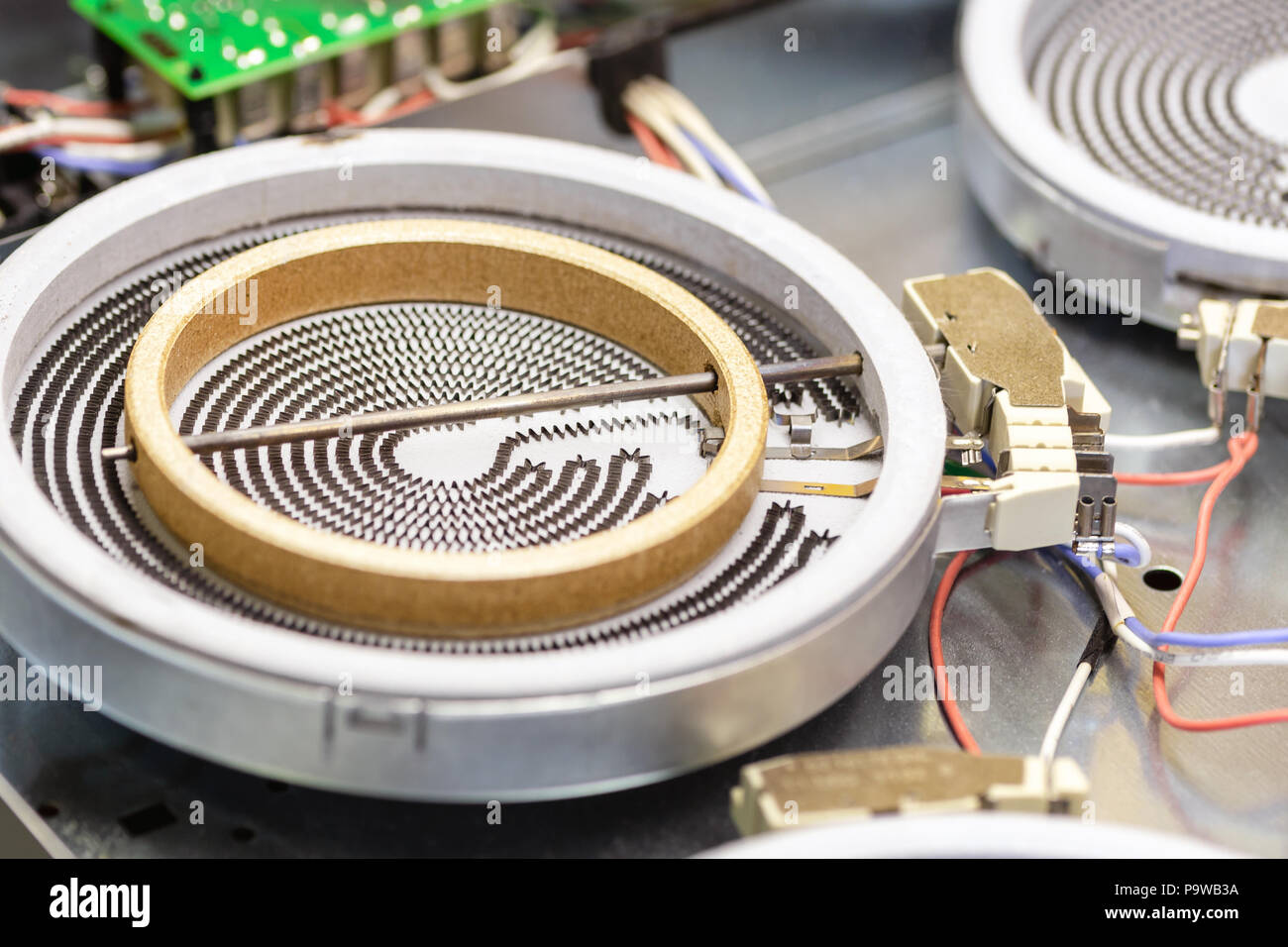 hight resolution of close up detail heating coil spiral of diassembled cooking stove cooktop repair and maintenance of house kitchen appliance at electric fixing worksho