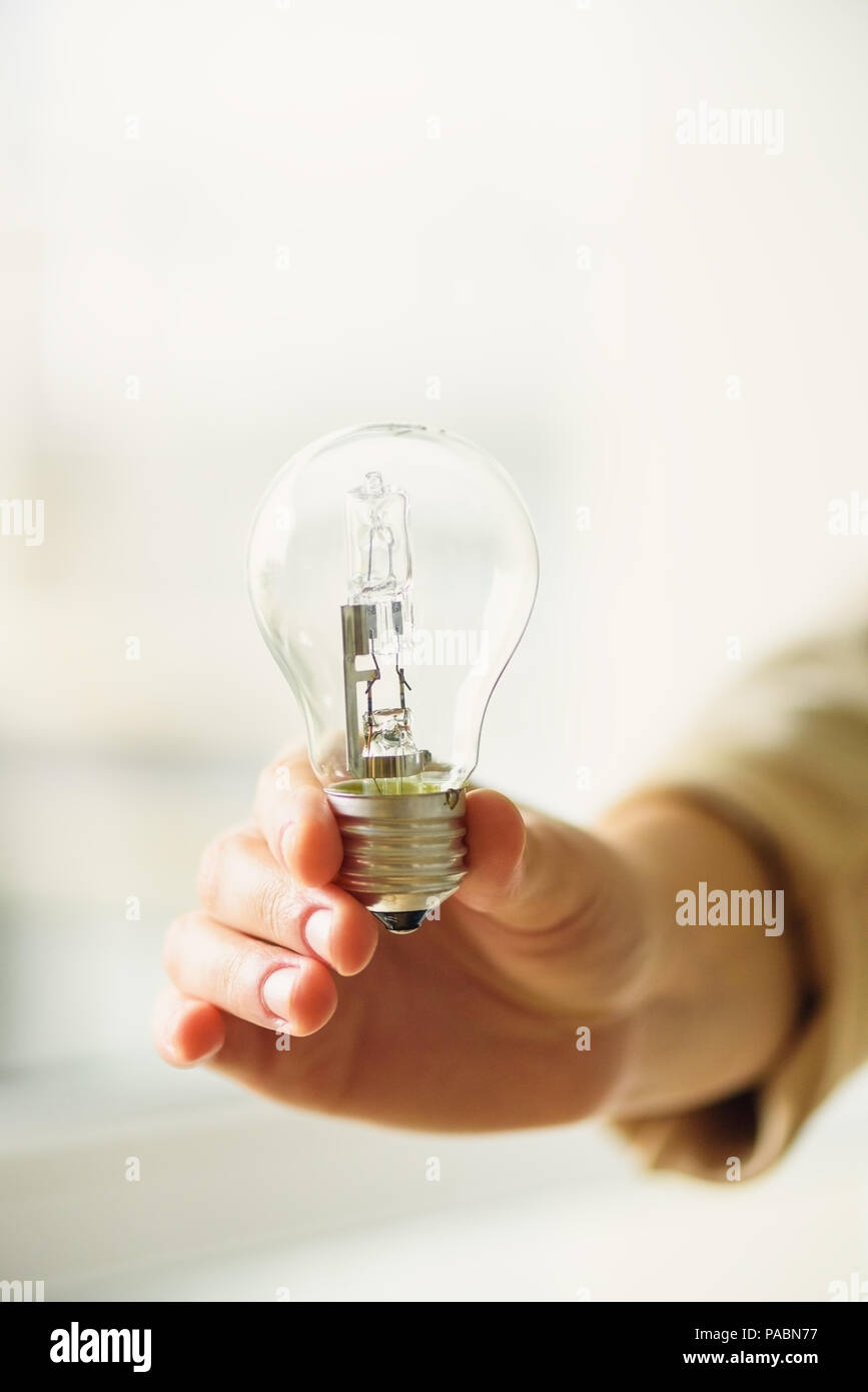 hight resolution of woman hand holding light bulb on cream background with copy space creative idea new business plan motivation innovation inspiration concept