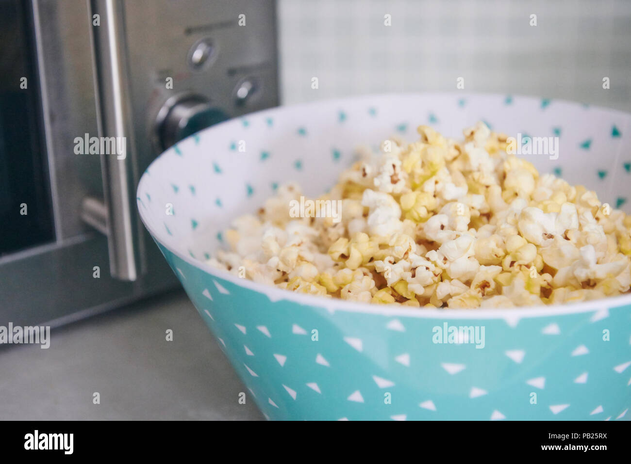 https www alamy com freshly popped microwavable popcorn in a teal and white bowl image213334126 html
