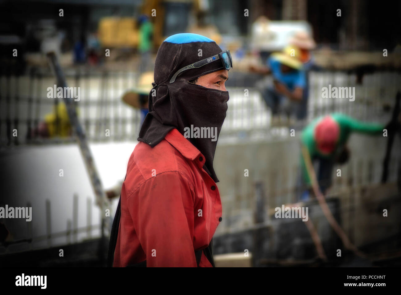 Thailand construction worker wearing heat protection head cover and facemask Stock Photo