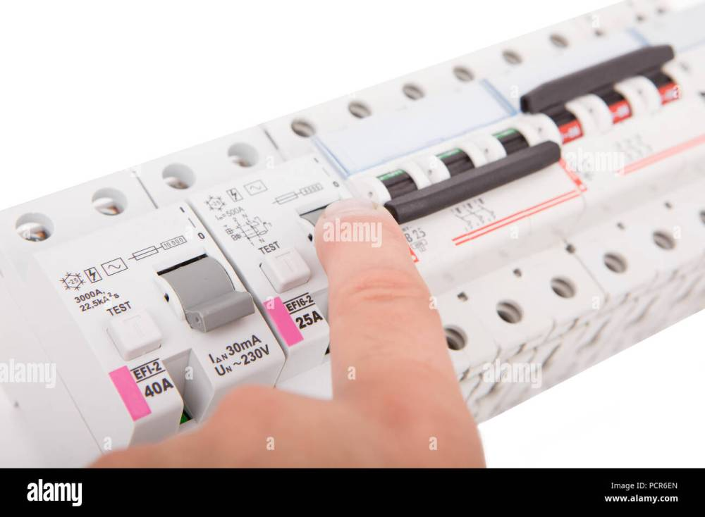 medium resolution of electric fuses man turning off the fusebox stock image