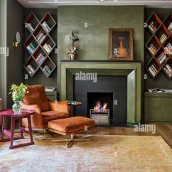 Living Room Footstool Rooms With Corner Tv Stands Stock Photos Images Alamy Vintage Armchair And Withlit Fire Wall Mounted Bookshelves Image