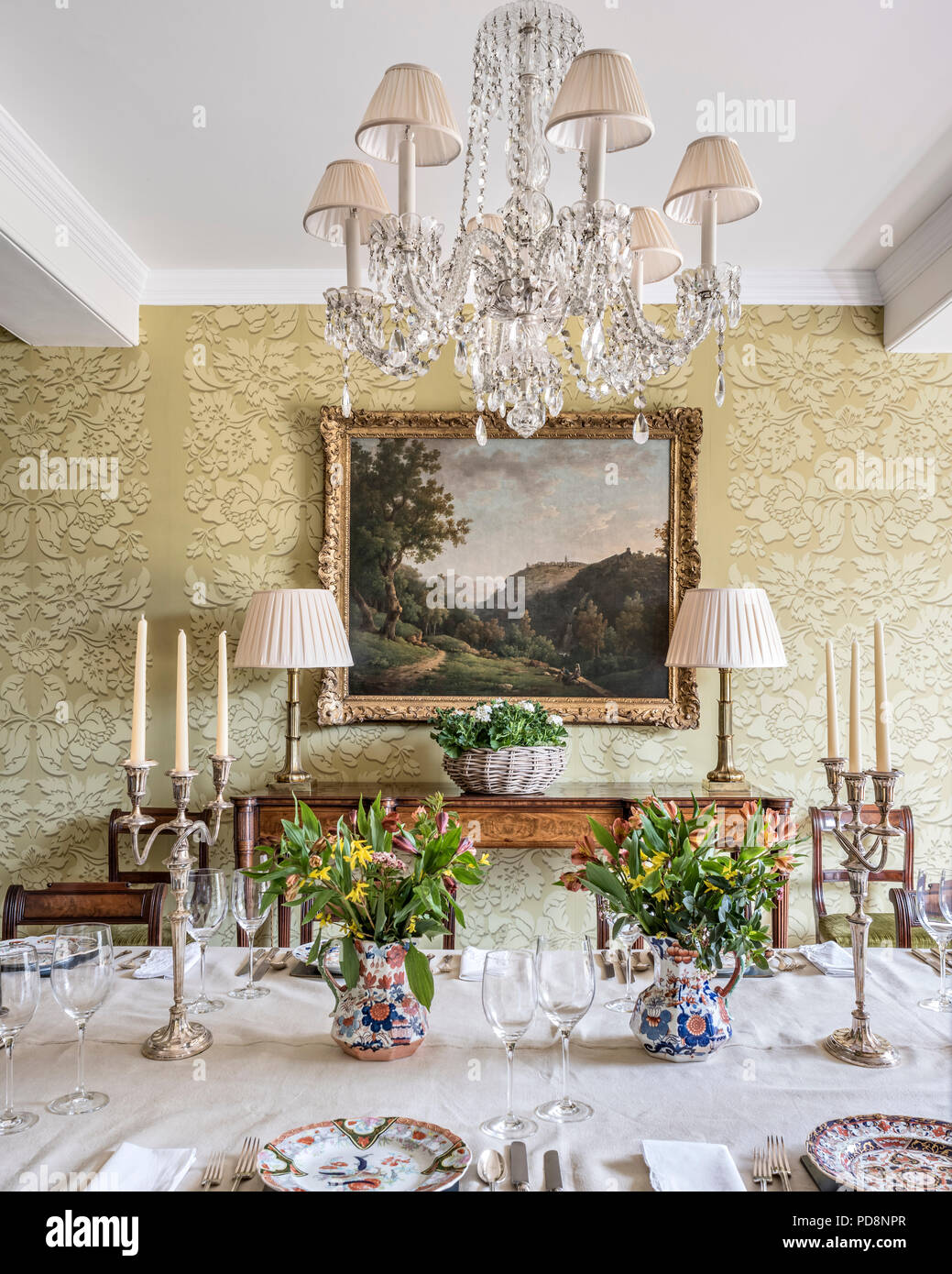 Large Framed Artwork In Dining Room With Glass Chandelier Stock Photo Alamy
