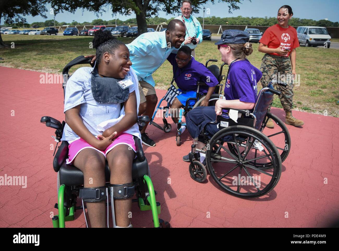 wheelchair olympics ergonomic chair design pdf vincent girley father of an athlete congratulates competitors after the 25 meter race during special mississippi 2018 summer games