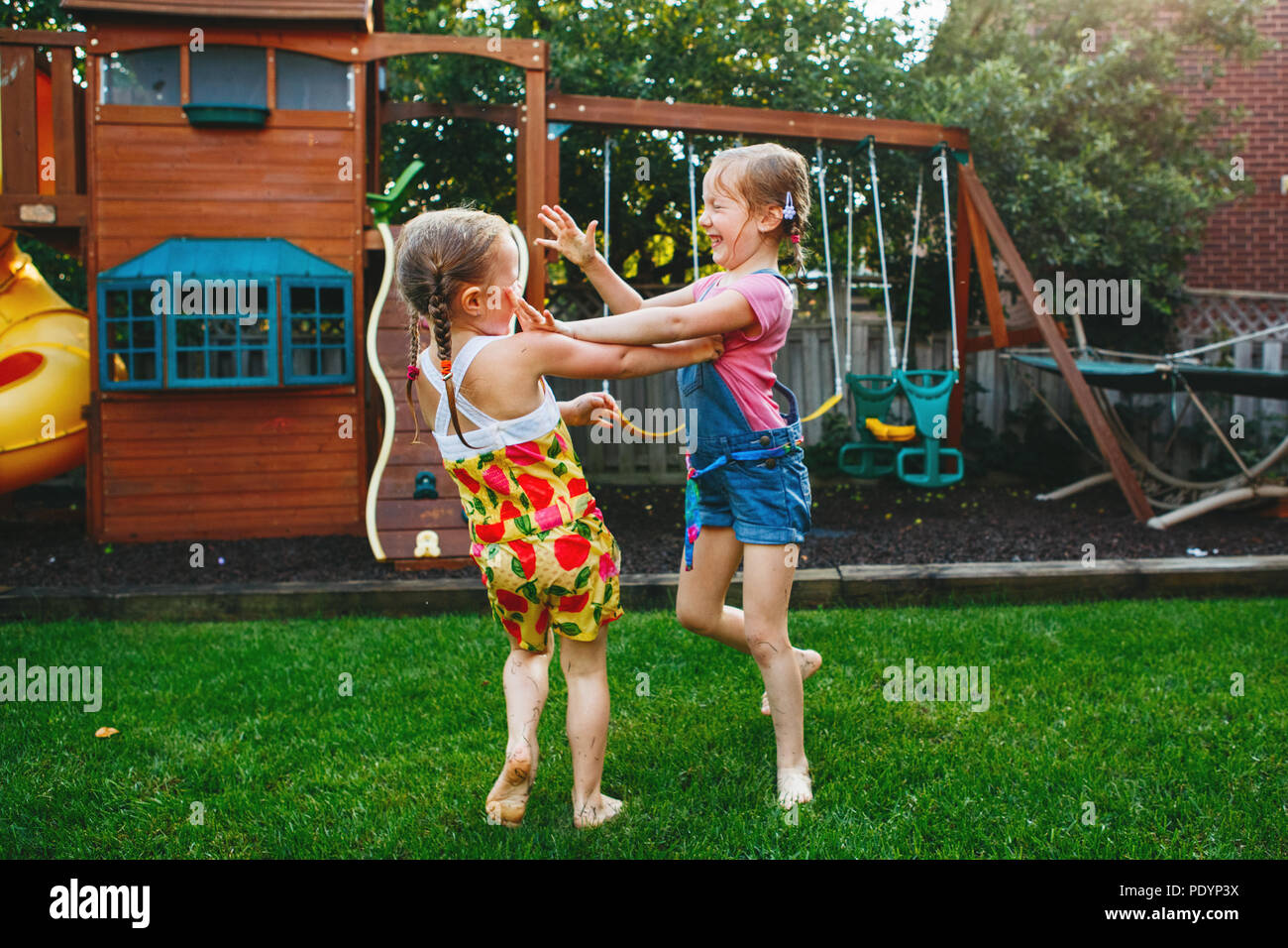 Portrait Of Two Little Girls Sisters Fighting On Home Backyard Friends Girls Having Fun Lifestyle Candid Family Moment Of Siblings Quarreling Play Stock Photo Alamy
