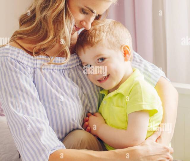 Group Portrait Of Beautiful Young White Caucasian Mother And Preschooler Child Boy Playing Together On Bed In Bedroom Mom With Son Hugging Cuddling I