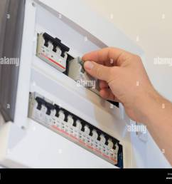 electricity fuse panel and lifting the fuse with hand stock image [ 1300 x 1064 Pixel ]
