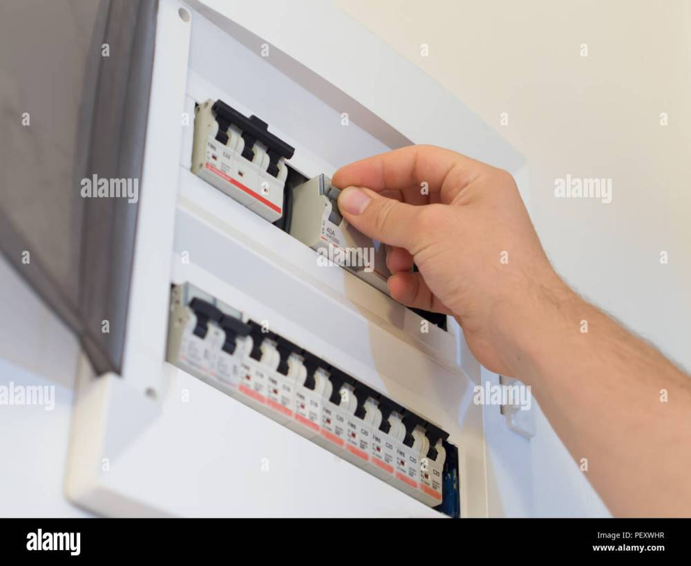 medium resolution of electricity fuse panel and lifting the fuse with hand stock image