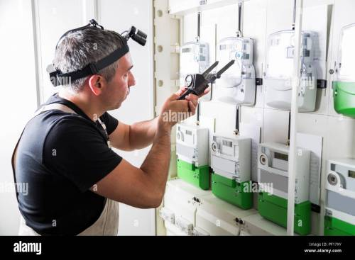 small resolution of electrician testing equipment in fuse switch box close up stock image