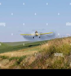 crop duster plane flying and spraying over crops in the palouse region of washington state  [ 1300 x 974 Pixel ]