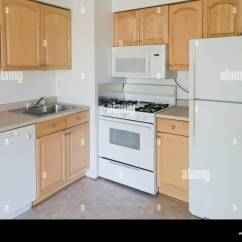 Modular Kitchen Usa Red Cherry Cabinets Small In A Condominium Unit Empty